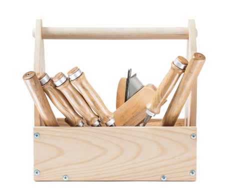 woodworking tools in wooden toolbox isolated on white