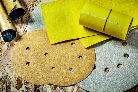 abrasive paper on plywood background