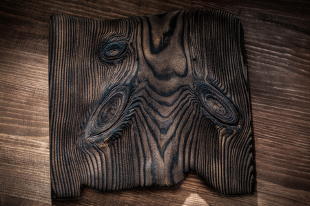 vintage wooden plate on dark wood background