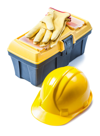 helmet and yellow leather toolbox with gloves on it isolated 版權商用圖片