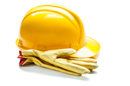 leather gloves  and construction yellow helmet isolated on white 免版税图像