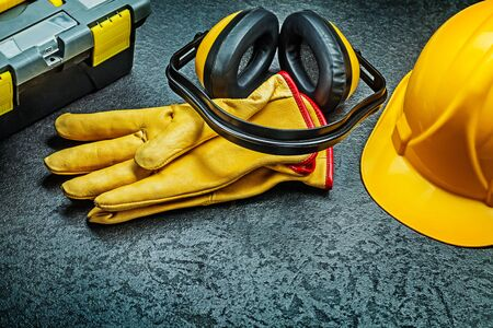 earphones and yellow leather gloves helmet tool box Stock Photo