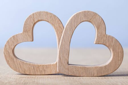 two wood hearts simbol of love