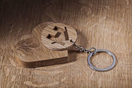 trinket house and heart symbols on wood backround Stock Photo - 124977365