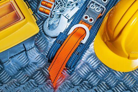 tool box helmet safety harness  on corrugated sheet Banco de Imagens - 124977366
