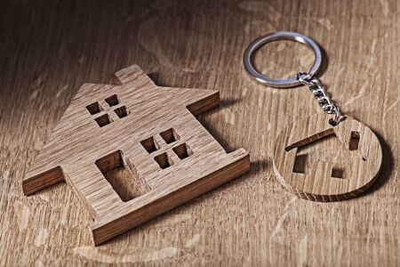 trinket house symbols on wood backround Banco de Imagens - 124977397