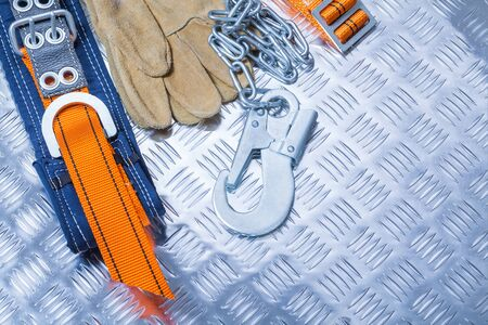 Construction safety harness  with gloves on corrugated metall sheet