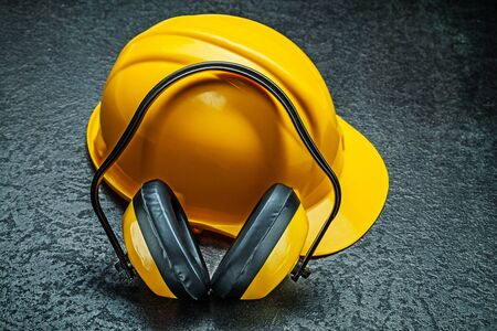 helmet with yellow earphones on black background Stock Photo