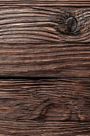 Vintage brown shabby wooden background.