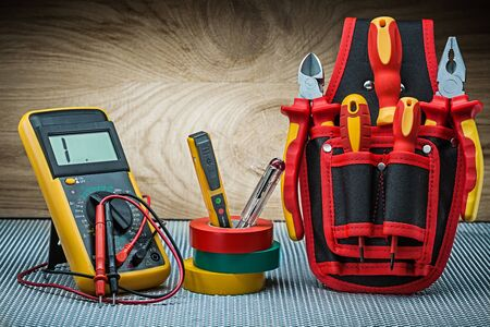 set of electrical tools on wood background