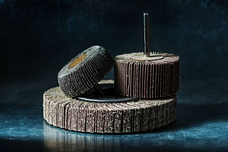 abrasive tools flap discs on metalic background