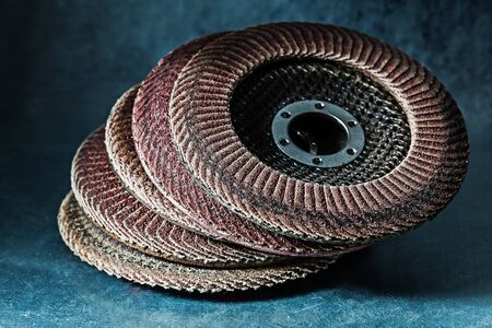 old used abrasive flap discs on metalic background