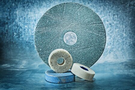 various size abrasive discs on metalic background