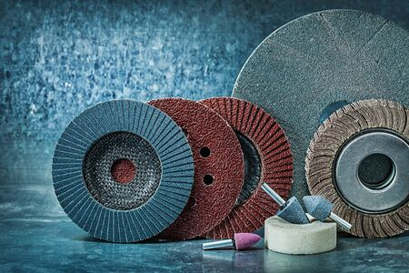 set of abrasive tools on metalic background