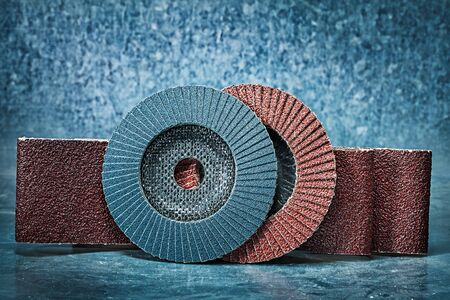 flap discs and abrasive tapes on metalic background