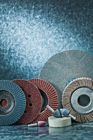 vertical version set of abrasive tools on metalic background