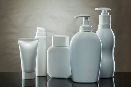 make up dispensers tube jar on brown background