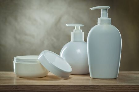 body hygiene products opened jar and pump dispensers white blank bottles