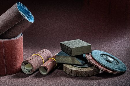 abrasive tools rolls of sandpaper with pads and flap wheels