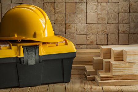 construction helmet on toolbox wooden background