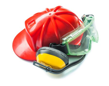 construction tools red helmet yellow headphones and green goggles isolated on white background