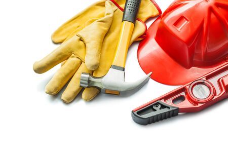 construction level red helmet claw hammer work gloves isolated on white
