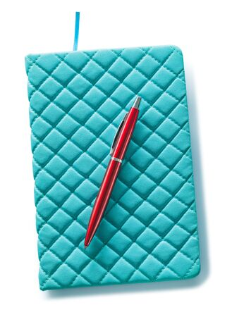 blue leather notepad and red ballpoint pen isolated on white