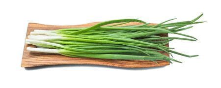 bunch of green onions on wooden chopping board with life eddge isolated on white Stok Fotoğraf