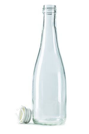 empty glass bottle with metalic cup isolated on white