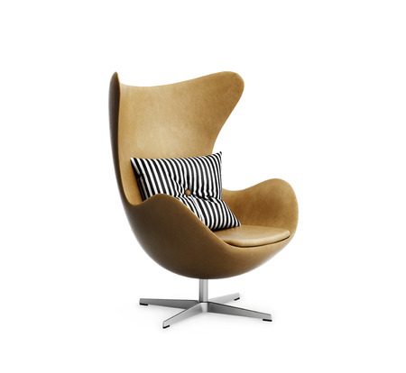 Isolated classic tobacco leather armchair with striped pillow