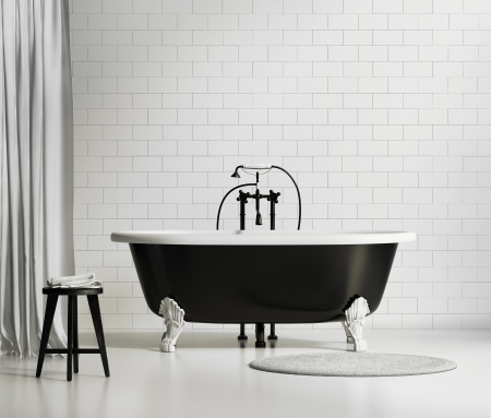 black bathroom: Black and white classic bathtub with sstool and rug Stock Photo