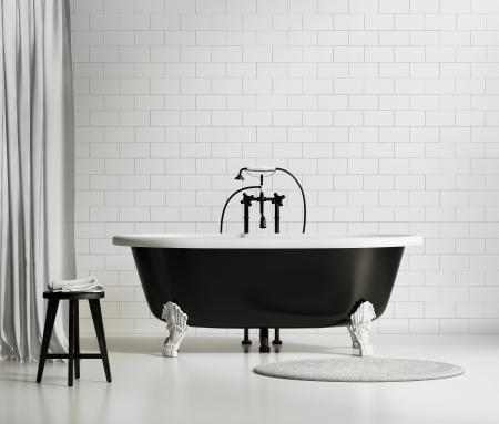 黑與白的經典浴缸與sstool和地毯