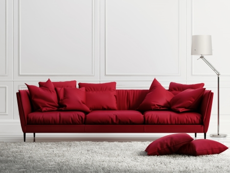 Red leather sofa in classic white style interior photo