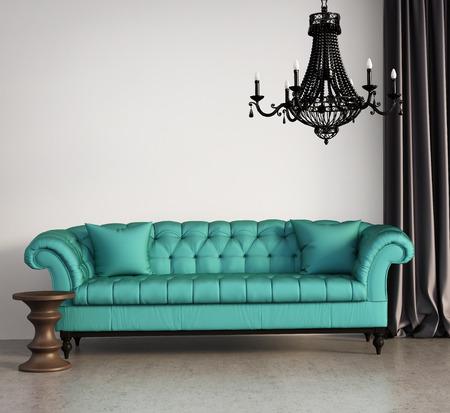 ビンテージの古典的なエレガントなリビング ルームには緑のソファとシャンデリア