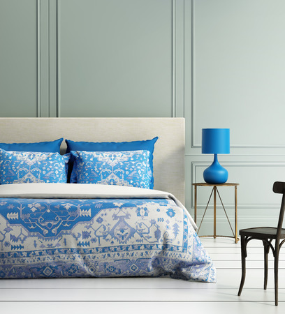 Contemporary elegant luxury atmospheric bedroom teal wall and blue textured duvet
