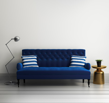 Contemporary elegant luxury blue velvet sofa with striped pillows Stock Photo