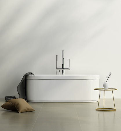 Modern bathroom with a white bathtub and a gold side table Archivio Fotografico