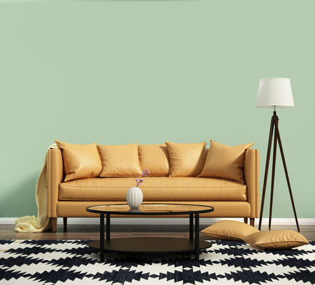 Living room with a leather sofa with green wall 스톡 콘텐츠