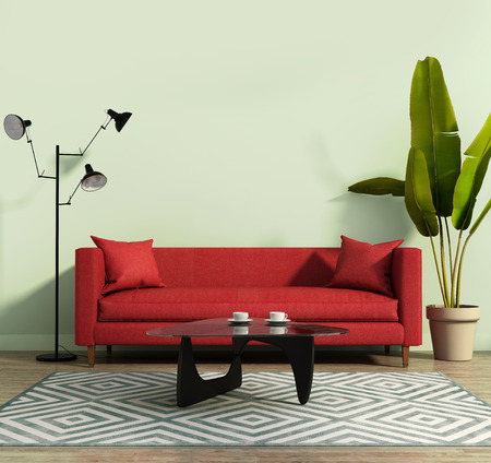 green couch: Living room with a red sofa and a geometrical rug