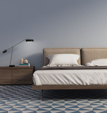 Blue bedroom with table lamp and tiles
