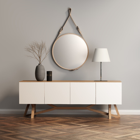 Buffet, console table on grey wall 스톡 콘텐츠