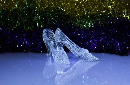 cinderella shoes: New Year shoes of Cinderella on the tinsel, as babackground
