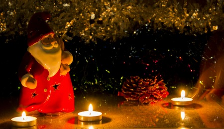 clause: night red santa clause with candles on the tinsel, as babackground