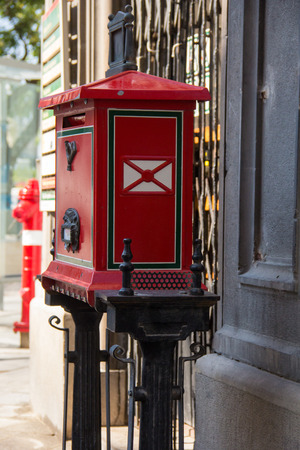 postmaster: Antique old red post office box on street