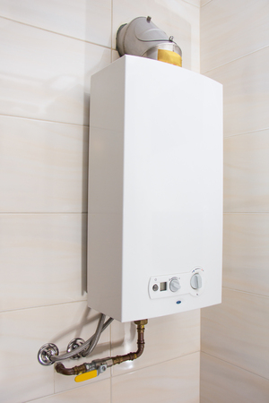 boiler: Home gas water heater - boiler in bathroom for hot water Stock Photo