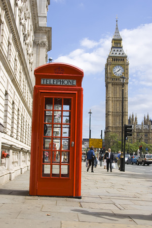Classical british red phone booth with Big Ben in background