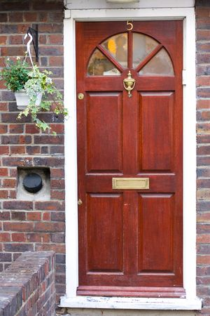 front door: Closeup of a wooden door of a traditional UK house