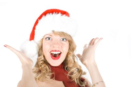 Girl in Santa hat wishing Merry Christmas photo