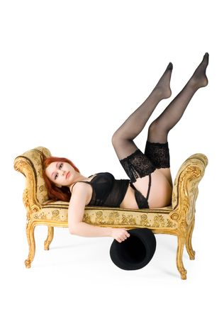 Girl in sexy black lingerie is comforty laying on victorian sofa photo