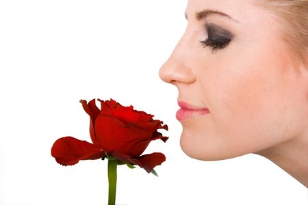 Close-up of young woman smelling red rose Stock Photo